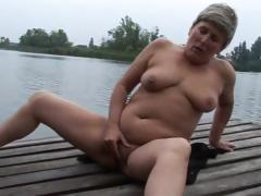 Granny is jerking outdoors